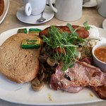 """large breakfast """"lots of extras hidden under the greenery"""""""