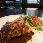Our grilled Chicken thigh served with seasoned mash potatoes & mesclun salad