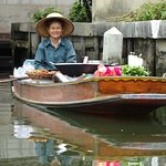 Lady selling food on the canal