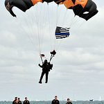 """U.S. Army Golden Knight parachute team member flying a """"Blue Line"""" U.S. flat in honor of Cmdr. B"""