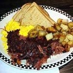 Corned beef hash, eggs, potatoes, toast