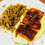 Pork belly with a Jack Daniels glaze over mashed potatoes with green beans