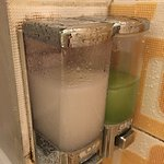 Dirt and mold all around shower gel and shampoo dispensers
