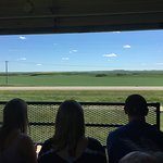 The open rail car provides great views of the prairie