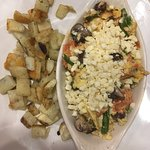 Plenty of feta and delicious veggies in it with scrambled eggs. Each potatoes were crispy enough