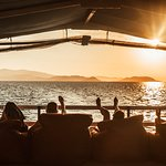 Why not grab a cold drink while we cruise back in the sunset?