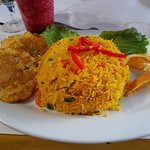 Tostones and Shredded chicken with yellow rice