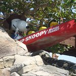 Snoopy near one the kids rides.