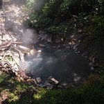 water bubbling with the heat of the volcanic activity below the pool