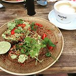 Smashed avocado with tomato on toast, with decaf flat white