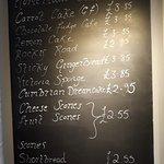 Blackboard advertising cakes on offer