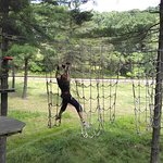 Daughter climbing the nets on one of the courses.