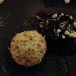 Dark chocolate cake with raspberry puree and coconut icecream