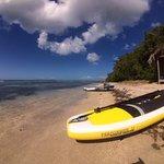 Stand up paddleboarding at Cades Bay