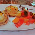 Eggs Benedict with a nice serving of fruit. Delicious.