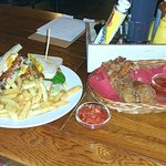 Club sandwich and fried chicken pieces