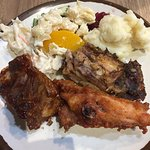 potatoes, rib, chicken, cole slaw and peach slice.