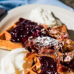 For the sweet tooth, a blueberry compote waffle with caramelized bacon!