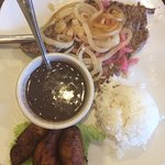 Palomilla Steak with grilled onions, rice, black beans, sweet plantains