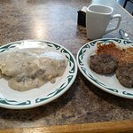 biscuits and gravy with a side of sausage patties and hashbrowns