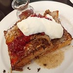The French toast spilling over with duck confit, cranberries and creme fraiche.