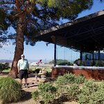 A view of the restaurant patio with airport in background.