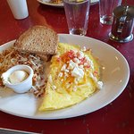 Omelette with cheddar,swiss and feta cheese, Hash browns and wheat toast.
