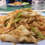 Not the Hotel, but a resto near the hotel offers the best ever pad thai. Pa-Noi Thai restaurant.