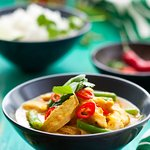 Mixing up our Thai Green Curry with some beans & hot peppers!