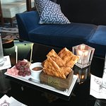 Port wine dheese tray with fried crackers, fresh honey and grapes.