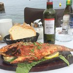 Fish of the day marinated in Indian spices and cooked in the Tandoor