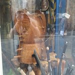 display window with leather armor