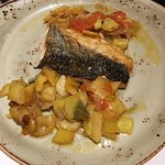 A copious portion of grilled hake served with saute potaoes & tomatoes.