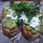 Avocado on toast, poached egg, parmesan shavings and watercress