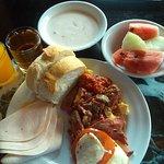 Breakfast Caprese salad, fruit, bread, homemade yogurt