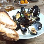Vermouth Mussels in a white vermouth sauce with leek and onion, served with toast