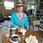 Enjoying cake and coffee.