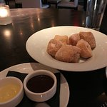 delicate pillows of fresh tender dough in cinnamon sugar and sauces