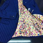 Blue pin stripe suit with glimpse inside looks.