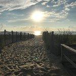 Sunrise seen at beach entrance on the Rehoboth Beach Boardwalk