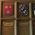 Coats of arms surround the dining room