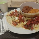 Pulled pork tacos with pinto beans and rice