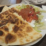Chicken quesadillas with salad and hot sauce