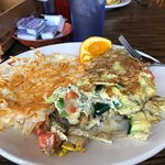 Vegetable omelette with hash browns and toast