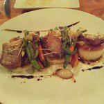 Scallops main with overdone pork on top and carrots