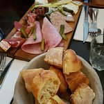 The very beautiful charcuterie board and baguette.