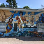 This historical mural was designed and painted by Muralist Fred Harrison.