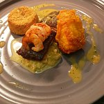 seared Halibut. saffron tempura monkfish. chickpea cake and a leek fondue