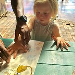 Very proudly putting her handprint on her Eco Kid certificate