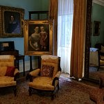 Main Parlor with pictures of family